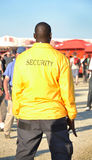 Black security guard wearing yellow jacket royalty free stock images