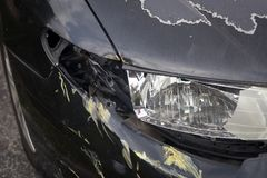 Black sedan after front side swipe. Black sedan after an accident with no insurance Royalty Free Stock Photo