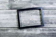 Black see-through frame. On wooden wall. Mock up Royalty Free Stock Photography