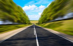 Black serpentine of asphalt road in sunny day. Royalty Free Stock Photos