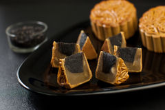 Black Sesame Flavor Mooncake with White Lotus Seed Stock Photo