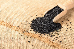 Black sesame on the linen mat Royalty Free Stock Image