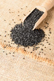 Black sesame on the linen mat Royalty Free Stock Photos