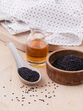Black sesame oil and sesame seeds Royalty Free Stock Photos