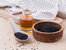 Black sesame oil and sesame seeds Stock Photos