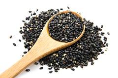 Black sesame. Pile of black sesame on wooden spoon Stock Images