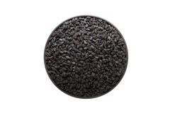 Black sesame seeds in clay bowl isolated on white background. Se Royalty Free Stock Photography