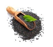 Black sesame seeds. Isolated on white background. Stock Image