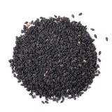 Black sesame seeds on white by top view Stock Images
