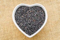 Black Sesame in white bowl. Royalty Free Stock Images