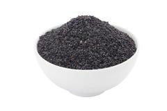 Black sesame in white ceramic bowl Royalty Free Stock Photos