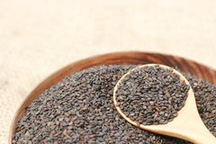 Black sesame. In wooden blow Royalty Free Stock Image