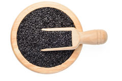 Black sesame in the wooden plate Stock Photos