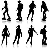 Black set silhouette of an athlete on roller skates on a white background.  Stock Image