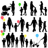 Black set of silhouettes of parents and children on white backgr Stock Image