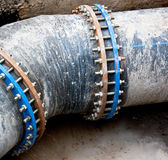 Black sewer pipe with bolt clamp Stock Photos
