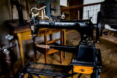 A black sewing machine in a workshop. Of an old german farm Royalty Free Stock Images
