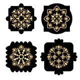 Black shapes with golden antiquarian  Stock Photos