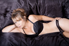 Black sheet and lingerie Royalty Free Stock Photography