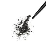 Black shimmery eyeshadow. Closeup of crushed black shimmery eyeshadow with makeup brush on white background stock photo