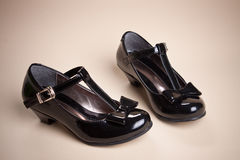 Black shine leather girl shoes with black ribbon Stock Images