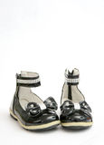 Black Shine Leather Girl Shoes . Bow Tie Stock Photography