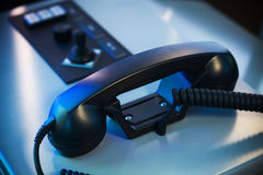 Black shining handset on captain bridge Royalty Free Stock Photography