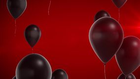 Black shiny balloons on a red background.