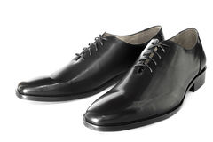 Black shiny leather shoe isolated. Royalty Free Stock Photos