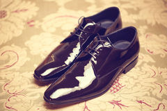 Black shiny leather shoes Stock Photos