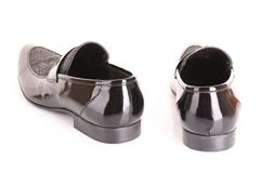 Black shiny man's shoe isolated Stock Photography
