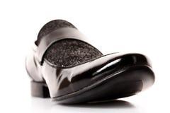 Black shiny man's shoe isolated Royalty Free Stock Photo