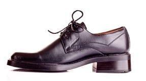 Black shiny man's shoe isolated. On white Royalty Free Stock Images