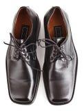 Black shiny man's shoe isolated Royalty Free Stock Photos