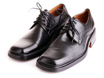 Black shiny man's shoes isolated Stock Images