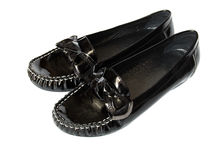 Black shiny moccasins isolated on white background Royalty Free Stock Photo