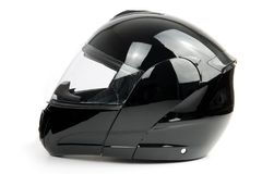 Black, shiny motorcycle helmet Stock Image