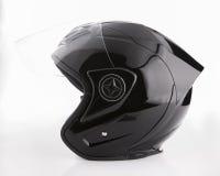 Black, shiny motorcycle helmet Isolated on white background Royalty Free Stock Photos