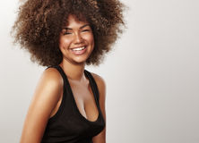 Black shiny woman with afro hair. In studio shoot royalty free stock photo