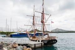 Black Ship with Blue Ferries Fotos de archivo libres de regalías