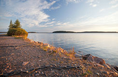 Black ships chain on the coast of Saimaa lake stock photos