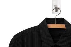 Black shirt on hanger. Black shirt hanging on wooden hanger Royalty Free Stock Photo