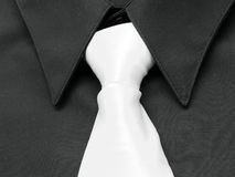 Black shirt. White tie Stock Photo