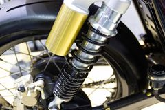 Black Shock Absorbers part of Motorcycle. Is a part for preventing shock stock photo