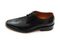 Black shoe isolated  on the white background. Black shoe isolated on the white background Royalty Free Stock Photo