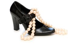 Black shoe and pearl necklace Royalty Free Stock Photo