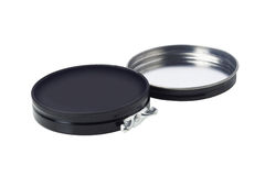 Black Shoe polish. In Open Flat Round Container White Background Royalty Free Stock Photos