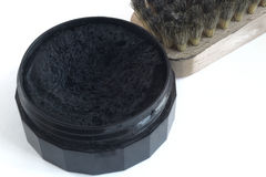 Black shoe polish and   brush for footwear Royalty Free Stock Image