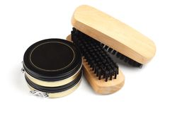 Shoe Polish and Brushes. Black Shoe Polish and Brushes on White Background Royalty Free Stock Images