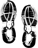 Black shoe prints on white Royalty Free Stock Images